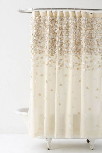 Like this shower curtain. Maybe a gold and cream/white bathroom theme?