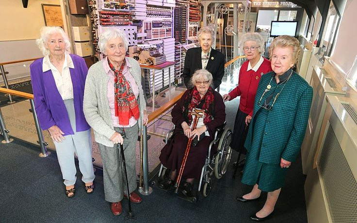 WRENS, who as young women helped crack Hitler's secret codes by operating the Colossus computer, meet once again at Bletchley Park after seeing their picture in The Telegraph. Codebreakers (left to right) Lorna Cockayne, Margaret Kelly, Joanna Chorley (wheelchair), Margaret O'Connell, Margaret Mortimer and Betty Warwick, with a working Colossus machine in the background.