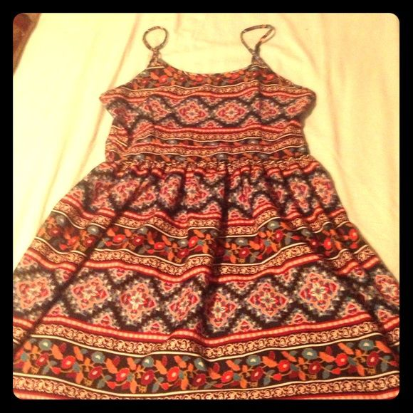 Bohemian print sundress Super cute short sundress in a beautiful print! I've only worn it twice but my chest got too big for it! Nice smooth material. Wonderful condition. 😊 It's Pink Dresses