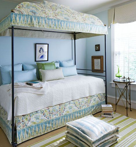 """Guest Bedroom    Wanting a tranquil and cocoon-like feeling for friends and family enjoying her guest room, Barbara introduced an iron canopy bed from Niermann Weeks that creates a small room-within-a-room effect. Contrasting fabrics over the bed frame include the """"Tamerlane"""" cotton print from Brunschwig & Fils, used for the outside canopy, and """"Cardomon,"""" a geometric by Vervain"""