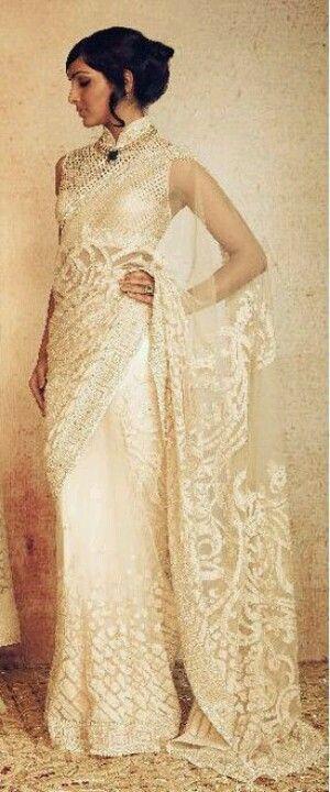 A delicate white saree, for a Christian bride, by Tarun Tahiliani.