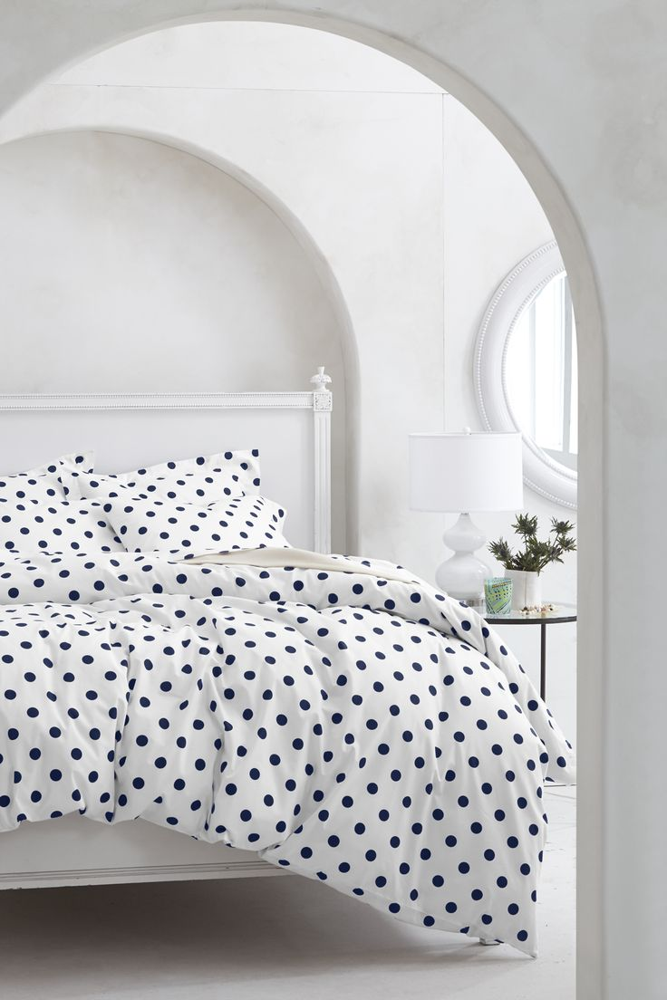Simple but beautiful monochrome bedroom.  Who doesn't love polka dot bedding?