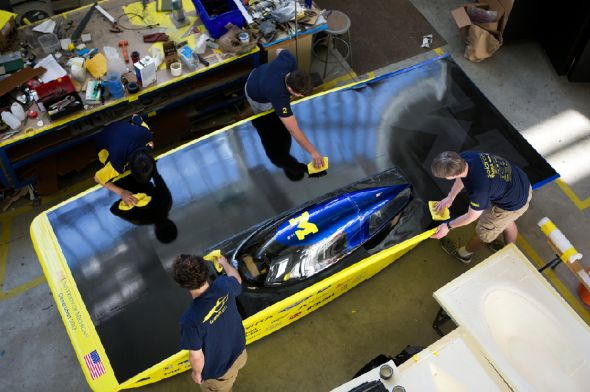 "University of Michigan students prepare the 2013 ""Generation"" solar car for its unveiling. More info at: http://precisionboard.com/product_users_tooling/from-concept-to-reality-the-university-of-michigan-solar-powered-car/"