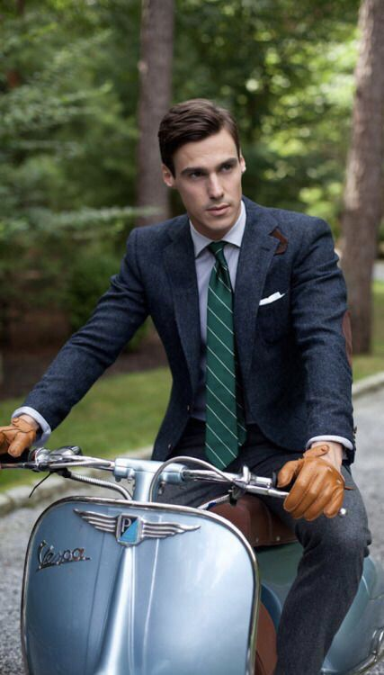 0f2947ae6e0 Dapper combo with a navy blazer green striped tie light blue shirt white  pocket square gray trousers brown leather gloves. model unknown.