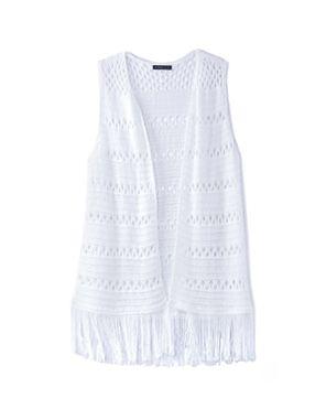 white crochet cover with tassel hem