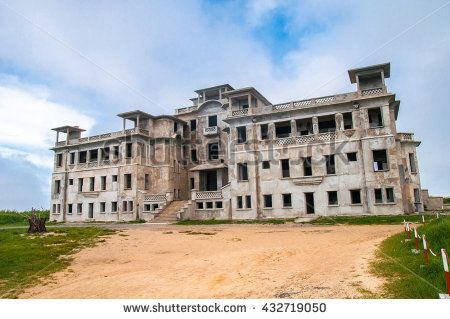 Abandoned hotel 'Bokor Palace' in Ghost town Bokor Hill station near the town of Kampot. Cambodia - stock photo