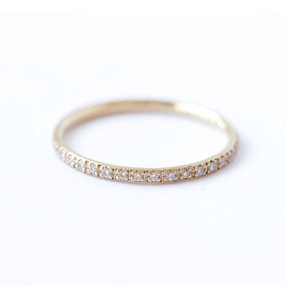 Full diamond eternity ring in solid gold. Skinny and refine ring, set with a sparkly 1 mm diamonds. The diamonds go all the way around the band.