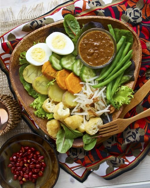GADO GADO Gado gado is an Indonesian salad which consists mostly of boiled or blanched vegetables accompanied by a sweet and spicy peanut dressing, similar to but not as rich as satay sauce. Like our FB Page www.facebook.com/placesbali