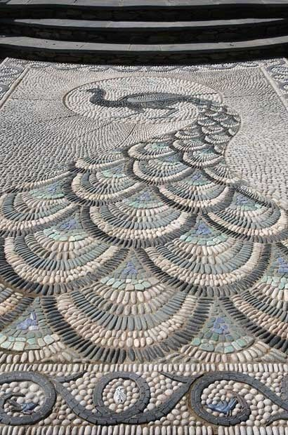 Very cool peacock mosaic.  Yes! At the entry way to my house??  Any tilers up for the challenge?