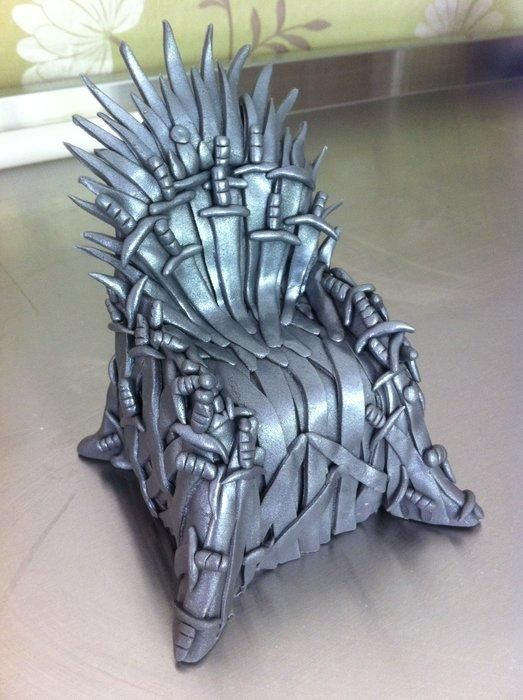Any Game Of Thrones fans here? I made this Iron Throne out of Asda's ready to roll icing and sprayed it with a little edible metallic paint :) Me and my other half are G.O.T mad, this was to go on top of his birthday cake.