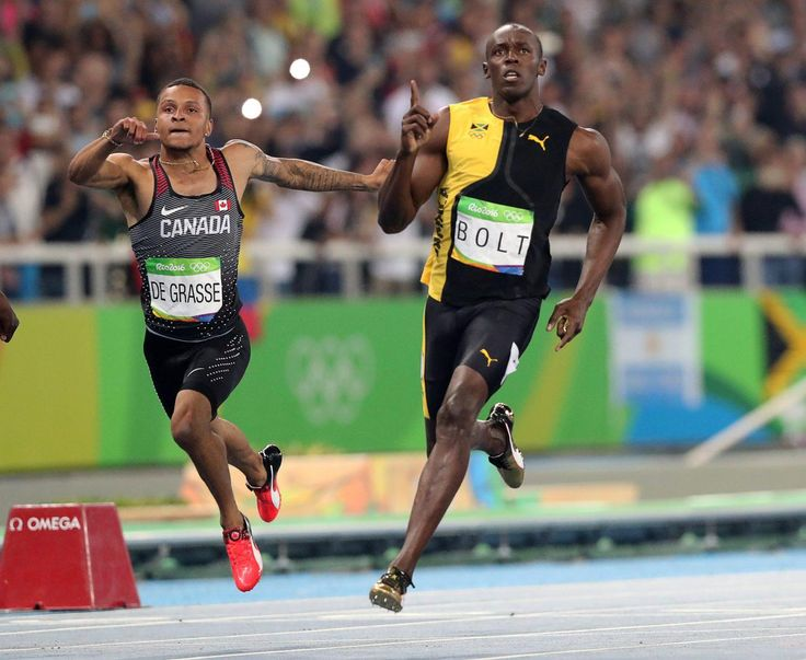 Jamaica's Usain Bolt celebrates as he crosses the line to win gold in the men's…