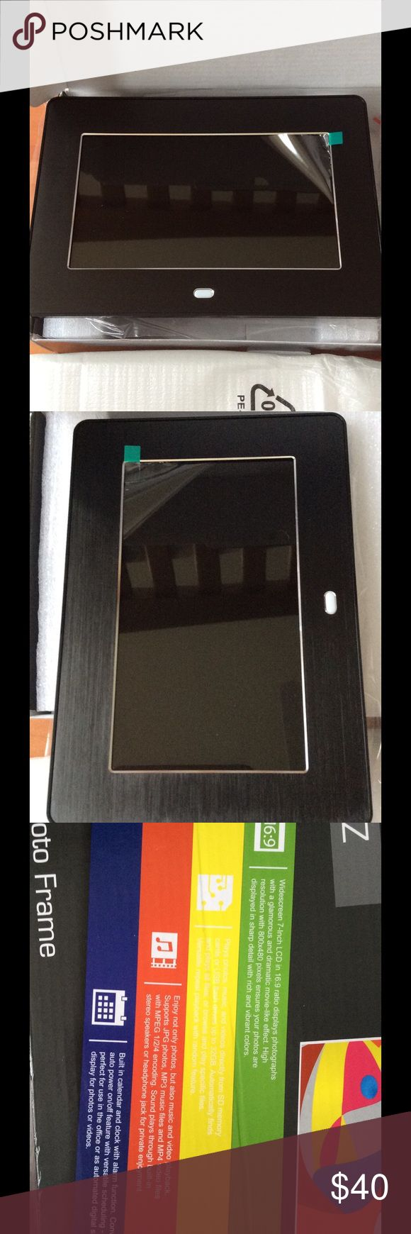New! 7-inch Digital Photo Frame 🖼 Never used, sealed with the original box. Widescreen.  16:9 ratio display photography with a glamorous and dramatic movie. 800 x 489 pixels. Play photos, music and videos directly from SD memory cards or USB flash drive up to 32 GB. Support JPG photos, MP3 music files and MP4 video files with MPEG 1/2/4 encoding. Built in calendar and clock with alarm function. Other