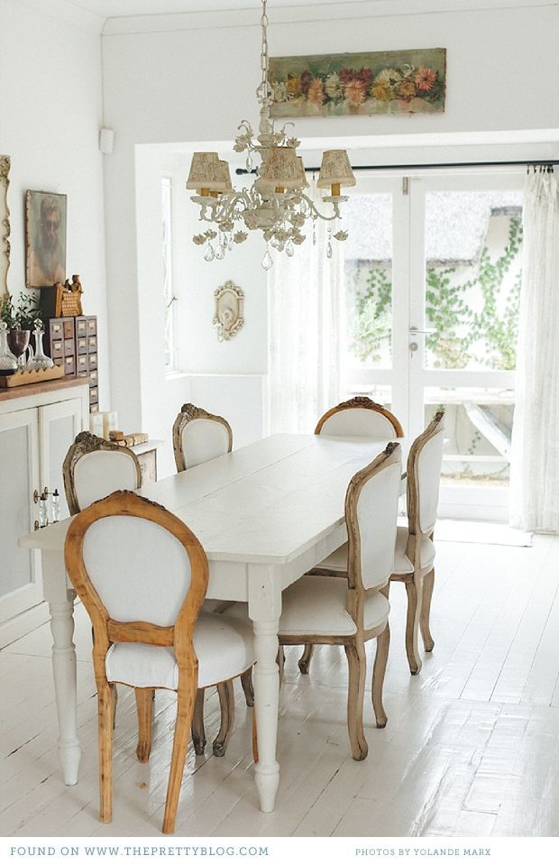French inspired dining room. I really like the white wood flooring.