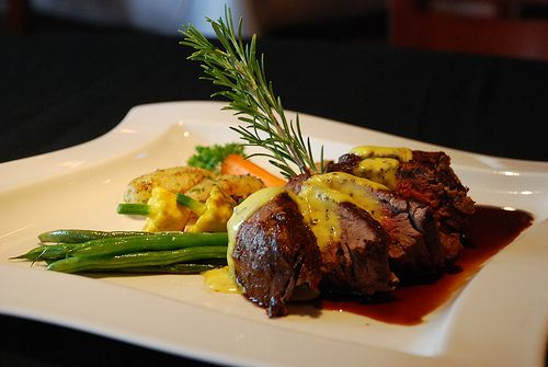 Chateaubriand with Bearnaise Sauce,  served with a seasonal vegetables, potatoes,  burgundy demi glace...linked Emeril's recipe to the image