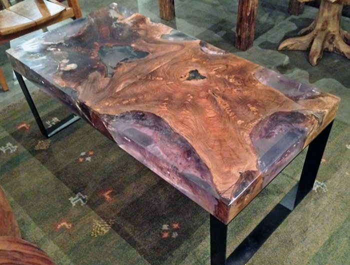 A Coffee Table Made From A Reclaimed Old Growth Teak Tree Trunk Section And Clear Resin On Steel