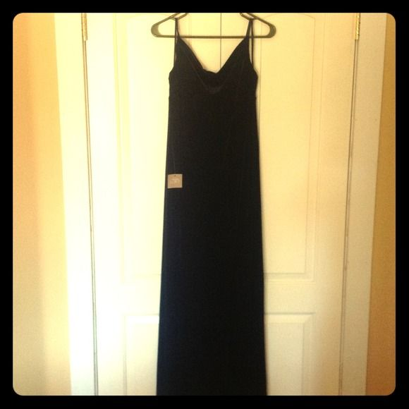 Anne Taylor LOFT - Velvet Dress - NWT Small/Medium Beautiful black velvet Anne Taylor Loft long formal dress with swoop neck. Size Small but fits between a small/medium. Brand new with tags Ann Taylor Dresses