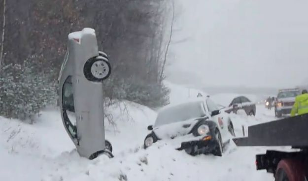 cars in ditches with snow | Video: Ford Fusion left vertical after snowy pile-up | CarAdvice