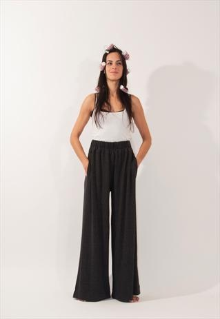Shope here:  https://marketplace.asos.com/listing/trousers/black-chic-trousers/572006