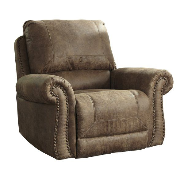 Dramatically transform your living space with the rustic look of weathered leather you love—at a fraction of the cost. That's the beauty of this faux leather rocker recliner. Washed in earthy Southwestern tones, with overstuffed back pillow support, jumbo window-pane stitching and gentle rocking motion—it envelops you in comfort and quality. Classic rolled arms bring in just enough of a traditional touch.