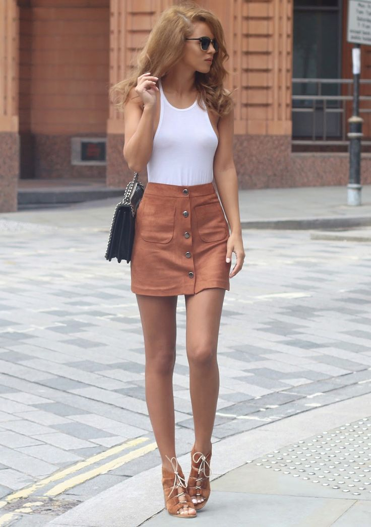 Wear your button front suede skirt with matching shoes and a white top. Via Nada AdelleVine Tank: Kit And Ace, Suedette Mini Skirt: Miss Selfridge, Bag: Zara, Sunglasses: Asos, Shoes: Carvela