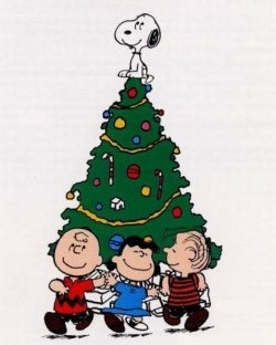 Snoopy doing his best angel impression on top of the Peanuts gang's Christmas tree.