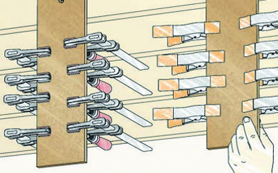 Unused overhead space provides a great solution for storing small clamps. One method is to use a pair of hangers to keep everything handy. The hangers are simply wide strips of hardboard with a hole drilled in one end. To make them more portable, you can hang the strips from nails.