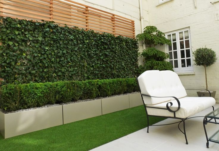 #Topiary courtyard in London with white beige and sable #planters, artificial…