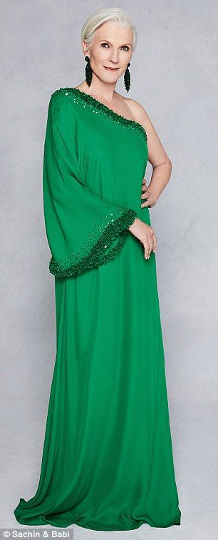 Designer: Among the outfits being modeled by Maye are several glamorous evening gowns, wit...
