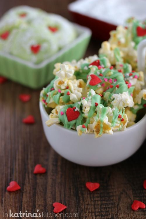 Grinch Popcorn - popcorn drizzled with green colored chocolate and mini hearts