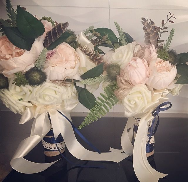 Bridesmaid and bride bouquets with feathers