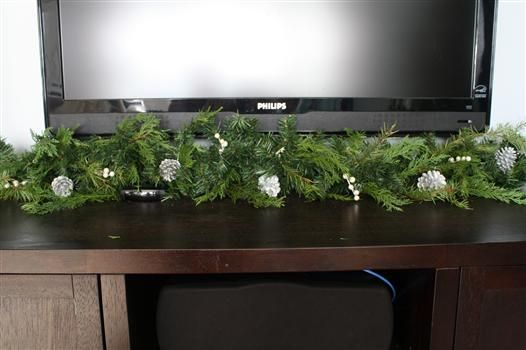 Double the Size of Your Garland!  While this trick takes a little legwork, it looks so much more natural. Why? Because it involves doctoring your faux stuff real greenery from your yard. It's best of both worlds, really — part free and authentic, and part reusable for next year.
