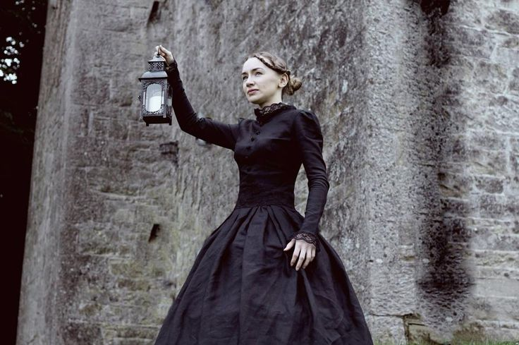 Irene Kelleher as The Governess in The Turn of the Screw. Costume Design by Samantha Kennedy