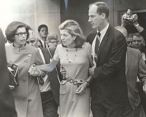Photograph by Charles O'Rear / Los Angeles Times    Patricia Lawford, Kennedy's sister, is escorted from Good Samaritan Hospital by family friend Jim Whitaker.