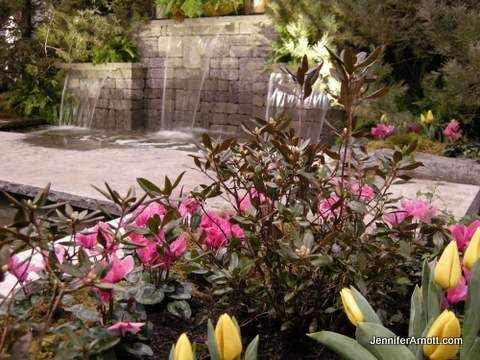 Waterfall and spring blooming flowers at Canada Blooms 2014