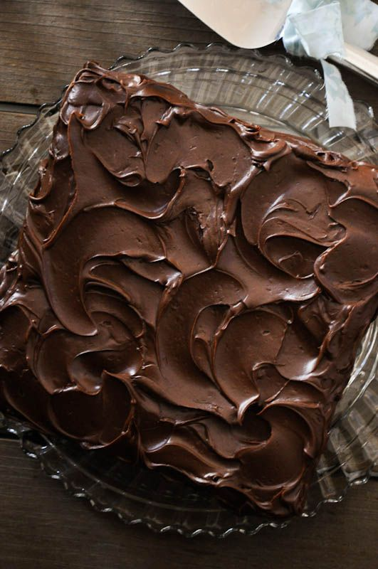 A moist chocolate cake with a fudgy frosting. Its flavor and texture improves with time.