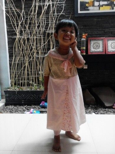 My little girl wearing dress made by bunda..hehehee