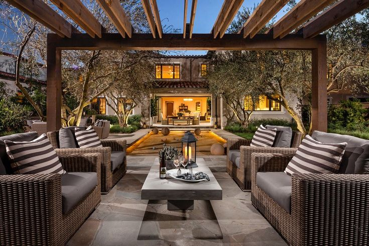 Bocce Ball Court for a Mediterranean Patio with a Striped Cushions and Trevi by Robert Hidey Architects