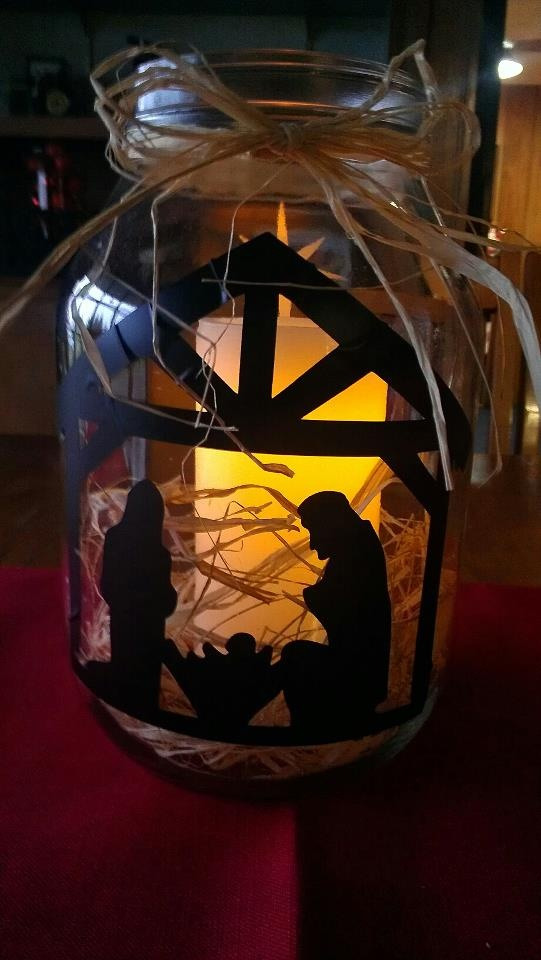 nativity on a gallon jar!  My sister designed and made this.  I am so proud!
