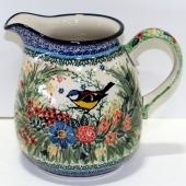 Polish Pottery milk pitcher.  Would love to find something like this for my collection.  Especially like the bird.