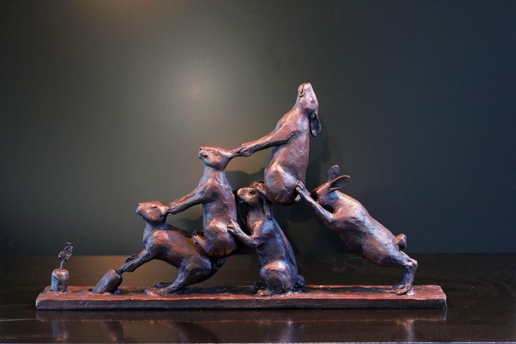 Teamwork - Bronze Sculpture of rabbits pulling a carrot out the ground by Bruce Little
