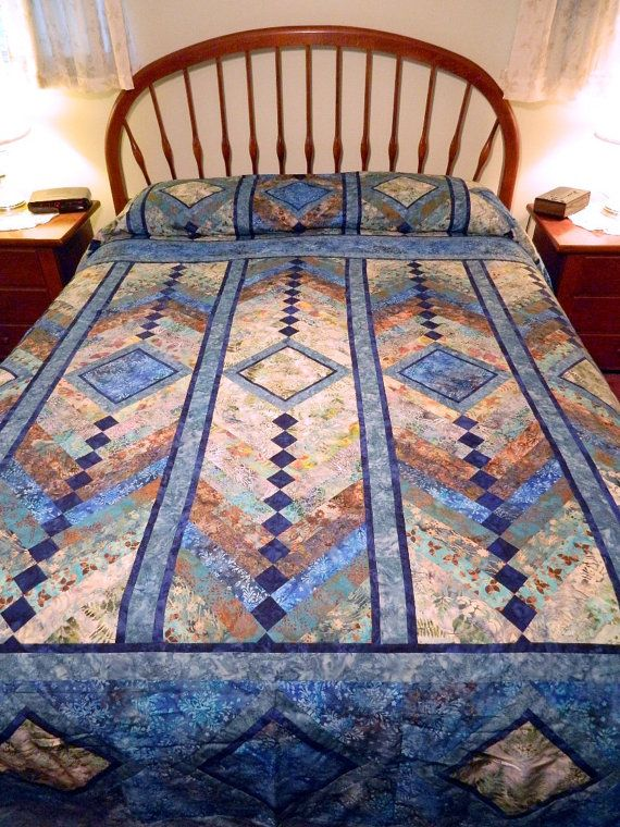 Handcrafted Queen size French Braid Batik by Quiltsbysuewaldrep, $1200.00 A special month for the QQQ Contest. It's our Anniversary / Birthday in April and so the entries are for such occasions! We're looking for the perfect gift :-)