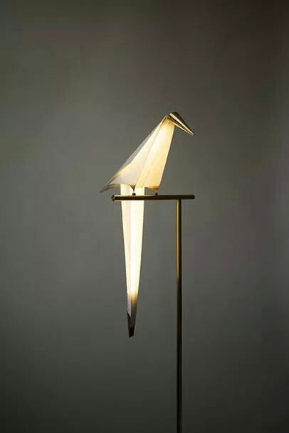 I like the idea of building a sculpture around the lightbulb. This one shows wonderful craftsmanship.