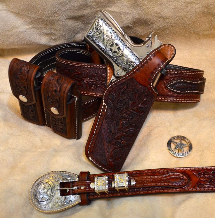 Colt 1911 Government 45.  Custom made Texas style gun rig and ranger style belt.  German silver 1911 grips and 4 piece ranger style buckle set.