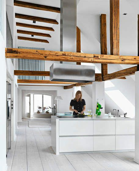 Integrating old wood beams into a clean, white, modern, open plan kitchen, living, dining area.  Oh, and its all underneath the inclined roof. via Tumblr