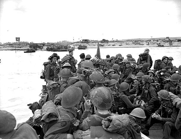 """Personnel of Royal Canadian Navy Beach Commando """"W"""" landing on Mike Beach, Juno sector of the Normandy beachhead. June 6th, 1944. Most are wearing Mk III helmets"""