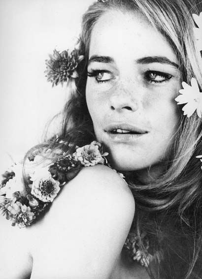 Charlotte Rampling with flowers in her hair