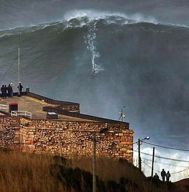 Big Wave Surfing Nazare Portugal 28.01.2013. Fun to look at, but I'm glad I'm not in that water