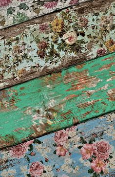 old boards with vintage wallpaper still attached