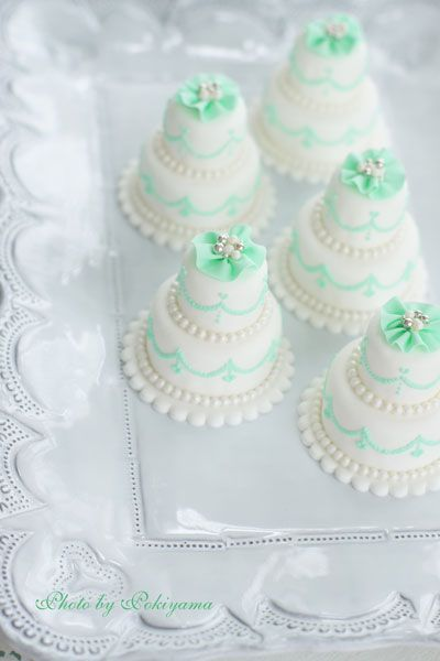 mint green mini wedding cake                                                                                                                                                                                 More