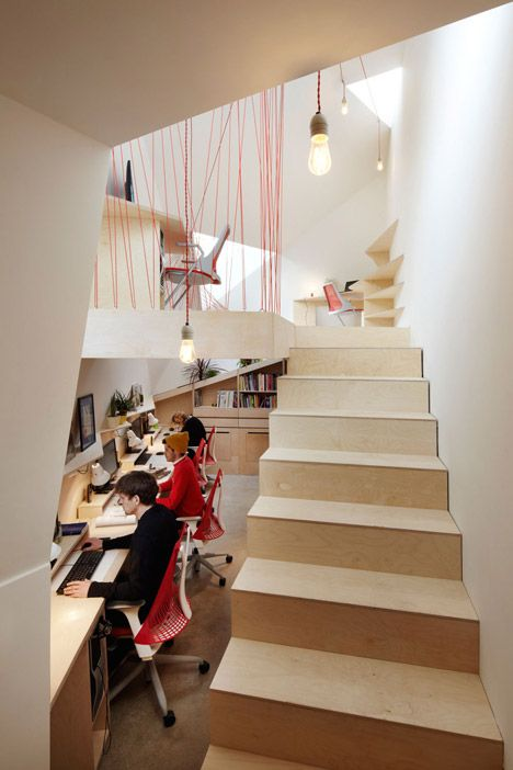 Parachute cables form netted balustrades at Fraher Architects' London studio / @Dezeen magazine | #workspaces